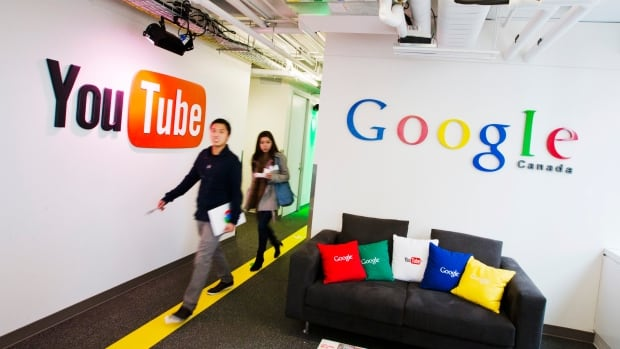google office video. people walk by a youtube sign at the new google office in toronto november 13 video f