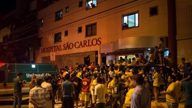 Soccer fans gather outside Sao Carlos Hospital where Brazil's soccer player Neymar was taken after being injured on Friday in Fortaleza.