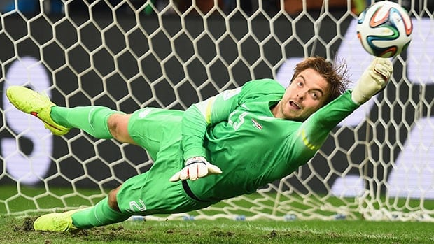 Did the psychological warfare tactics of substitute goalkeeper Tim Krul of the Netherlands make the difference? Krul saves a penalty kick by Michael Umana of Costa Rica, his second save of the shootout.