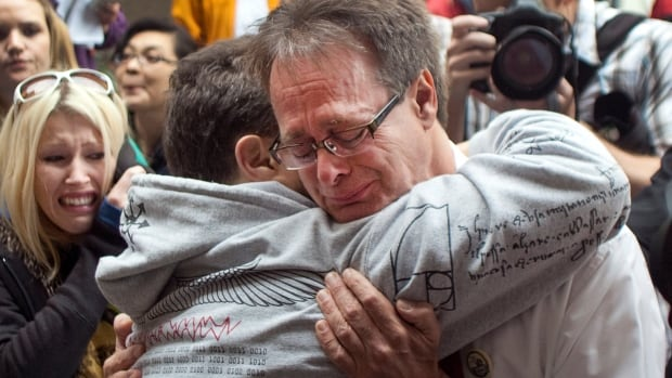 Marc Emery, right, perhaps Canada's most influential marijuana legalization activist, cries while embracing a friend before turning himself in at the court house in Vancouver, B.C. in 2009.