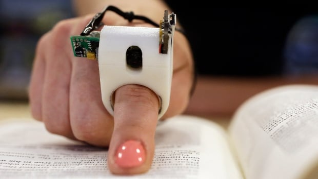 Researchers at Massachusetts Institute of Technology's Media Lab have designed and developed the FingerReader ring, which enables people with visual disabilities to read text printed on paper or electronic devices.