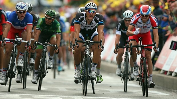 Marcel Kittel, centre, eked out victory by a half-wheel length in Stage 4.
