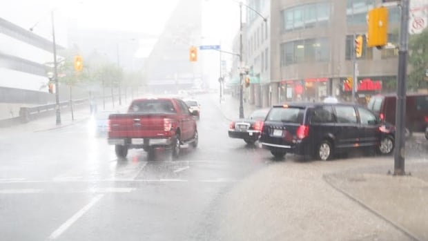 Toronto was under a severe thunderstorm watch for the first-half of Tuesday afternoon.  The image above was taken at Peter and Front streets.