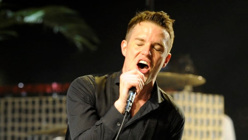 FILE - In this April 18, 2009 file photo, Brandon Flowers of The Killers performs during the band's headlining set on the second day of the Coachella Valley Music & Arts Festival in Indio, Calif. (AP Photo/Chris Pizzello, file)