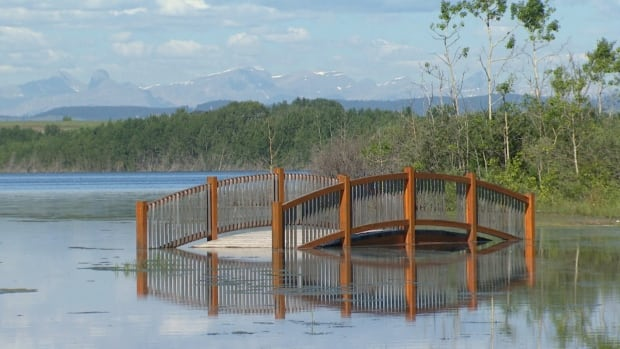 Rising waters at Cochrane Lake northwest of Calgary are threatening surrounding properties.