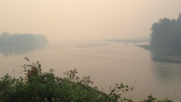 Smoke hovers in the sky near Kakisa, N.W.T. The community of about 50 people was evacuated for a week as fires raged. Smoke from the 137 forest fires burning in the territory is now travelling as far as Saskatchewan and Manitoba.