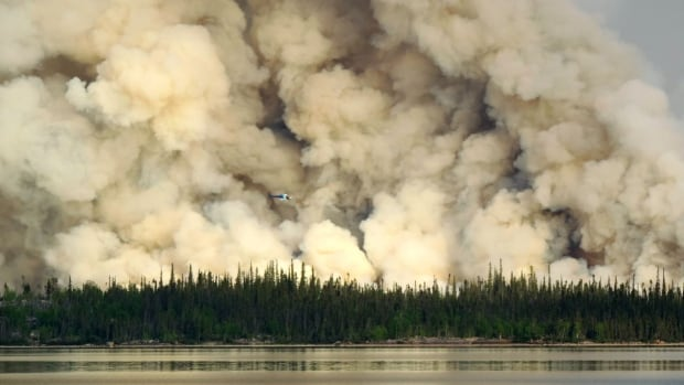 Smoke billows from a forest fire near Gameti, N.W.T. in one of the worst forest fire seasons the Northwest Territories has seen in decades. More than 130 wildfires are burning around the territory.