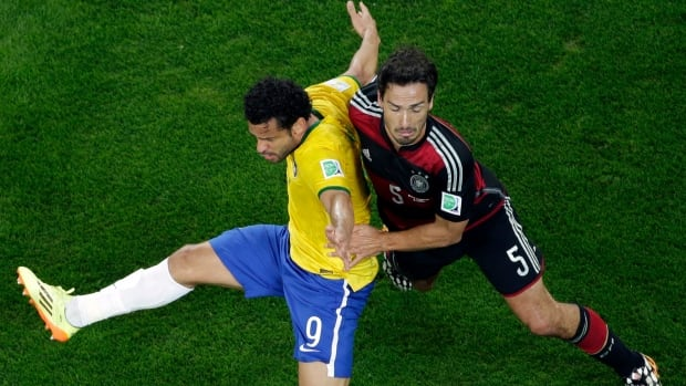 Germany's Mats Hummels, right, injured his knee in the World Cup semifinal win against Brazil. (Felipe Dana/Associated Press)