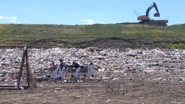 Police officers probe the Spyhill landfill site for clues, a move officers described as 'standard procedure.'