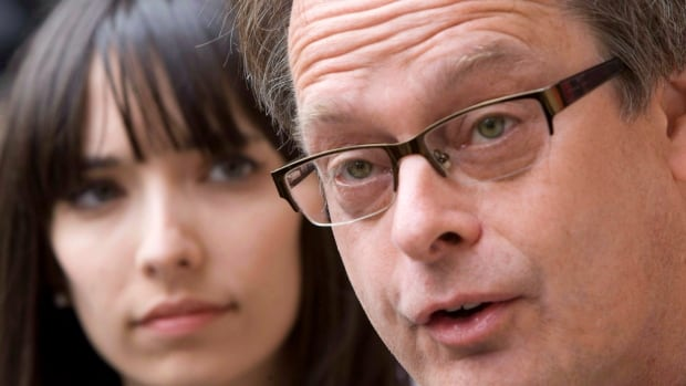 Marc Emery, the self-described 'prince of pot,' speaks to reporters outside the B.C. Supreme Court in Vancouver on May 10, 2010 as his wife Jodie looks on, just before he turns himself in to be extradited to the United States.