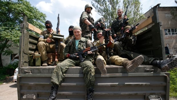 Pro-Russian separatist fighters set out from a base in the eastern Ukrainian city of Donetsk. Ukrainian forces regained more ground but sustained further casualties on Thursday in clashes with separatists.