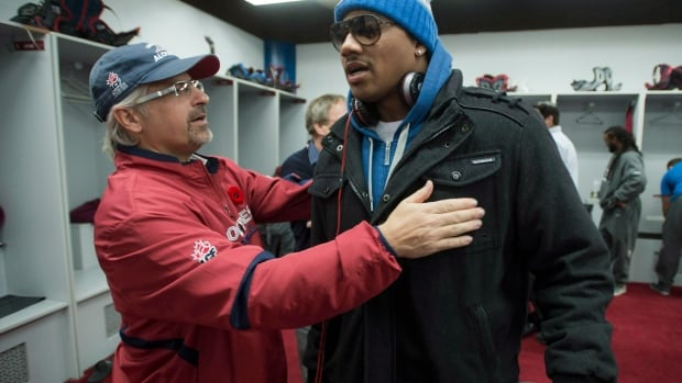 Alouettes general manager Jim Popp, left, has signed a three-year contract extension to remain in Montreal.