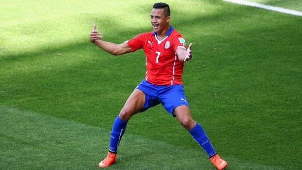 Chile's Alexis Sanchez, seen here celebrating a Chilean goal a week ago at the World Cup in Brazil, has signed on with Arsenal.