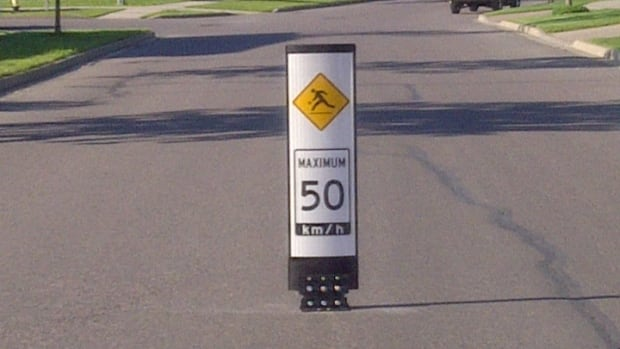 Ped-zone markers, such as this one along Sunrise Boulevard, remind drivers to slow down.