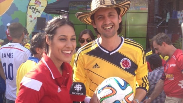 CBC's Carly Agro, left, interviews a Colombian soccer fan during the Soccer Nation tour.