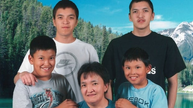 Edward Snowshoe, top right, poses with his family from Fort McPherson, N.W.T. In 2010, age 24, Snowshoe died by suicide at Edmonton Institution, a maximum-security federal prison, after spending 162 days in segregation. Corrections officers say they were not aware of his three previous suicide attempts at a prison in Manitoba.