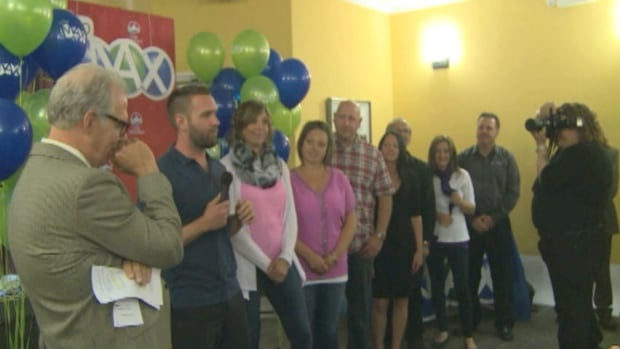 "The ""United 8"" were in Wabush on Friday to collect their $30-million Lotto Max prize."