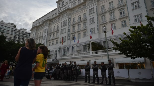 Security personnel are seen here standing guard outside the Copacabana Palace hotel, the official accommodation for FIFA executives, following the arrest of a director of Match Hospitality, a subsidary company of FIFA, over illegal cup tickets. Ray Whelan was later released and fled before being re-arrested.