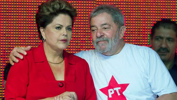 How rough can it be? Brazil's President Dilma Rousseff is comforted by her predecessor Luiz Inacio Lula da Silva at the national convention of their Workers' Party in June 2014, as Rousseff was confirmed as the party's presidential candidate for October.