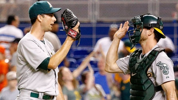 Pitcher Jeff Francis, left, was traded by the Oakland A's to the New York Yankees on Friday. The North Delta, B.C., native made only nine relief appearances with Oakland, going 0-1 with his first career save and 6.08 ERA. He is 0-2 with a 5.89 ERA in 10 games this season with Cincinnati and the A's.