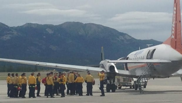 Twenty Yukon firefighters board an Air North flight Friday afternoon to help out beleaguered crews in the N.W.T., which is facing its worst wildfire season in decades.
