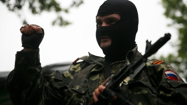 A pro-Russian fighter mans a checkpoint in the eastern Ukrainian city of Donetsk in early July.