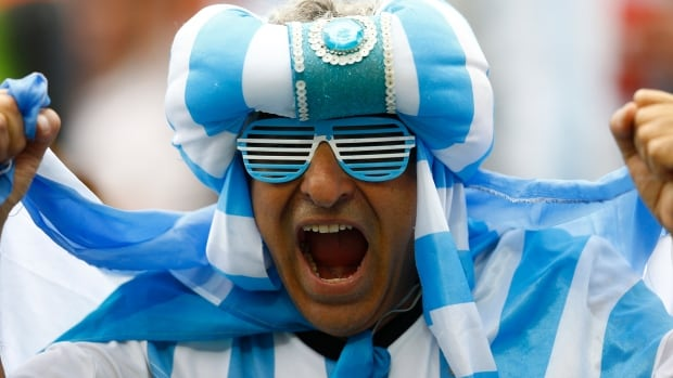 An Argentine fan cheers before the start of the 2014 World Cup semi-finals between the Netherlands and Argentina at the Corinthians arena in Sao Paulo July 9, 2014.