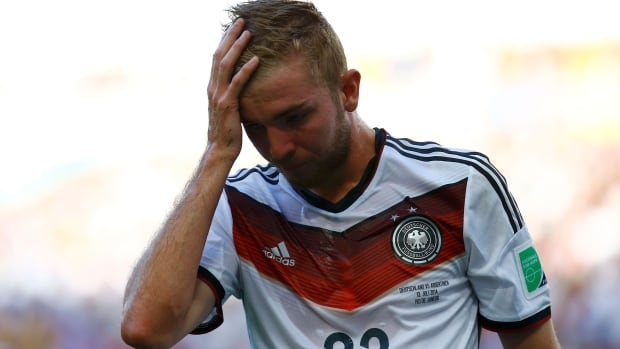 German midfielder Christoph Kramer continued playing after suffering an apparent head injury early in the FIFA World Cup final. He was eventually substituted in the 31st minute and appeared wobbly.