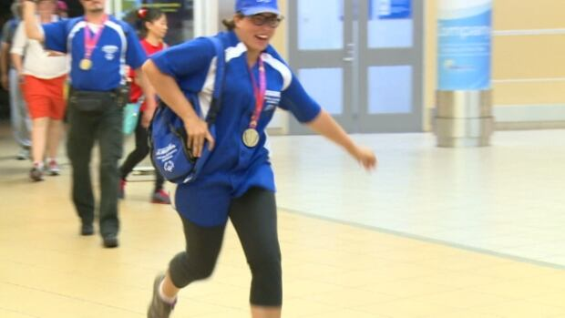 One athlete runs to her family after returning from the Special Olympics Canada 2014 Summer Games held in Vancouver.