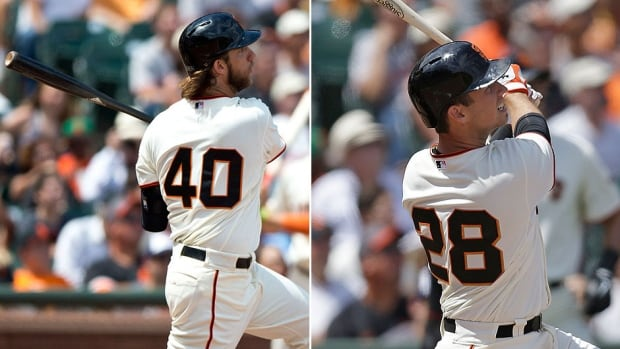 Giants pitcher Madison Bumgarner, left, and catcher Buster Posey show off their home-run strokes as they accounted for all eight of their team's run production in a 8-4 doubling of Arizona on Sunday. They became the first pitcher and catcher in major league history to hit a grand slam in the same game.