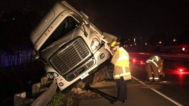 A rolled truck at Erin Mills on the QEW has closed two lanes of the highway during Monday morning's commute.