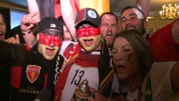 The scene scene at the Teutonia Club on Sunday included waving German flags, painted faces and cheers of celebration after Germany won the FIFA World Cup.