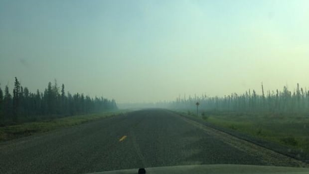 Highway 3 was briefly opened to traffic Saturday morning, then promptly closed again due to a fire south of Chan Lake.