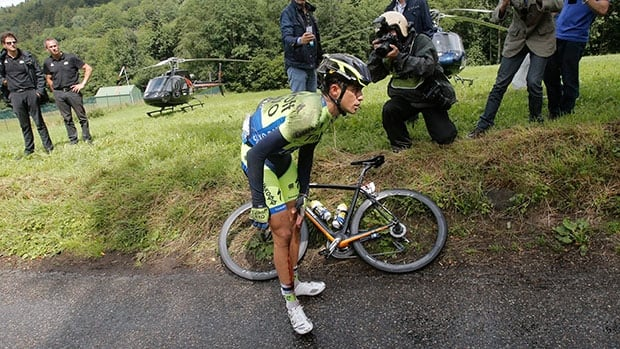 Spain's Alberto Contador holds his knee after crashing prior to abandoning the race in the tenth stage of the Tour de France on Monday.