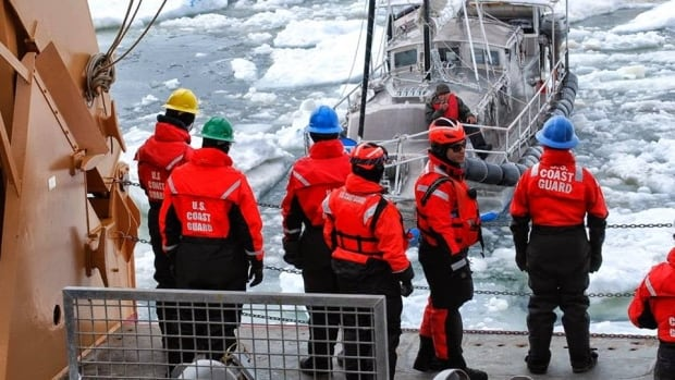 Crew on board the U.S. Coast Guard Cutter Healy, a polar icebreaker, tow the 9-metre Altan Girl through the sea ice about 65 kilometres northeast of Barrow, Alaska Saturday.