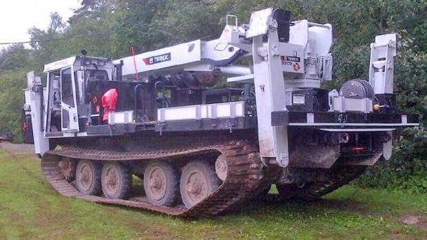 NB Power crews are using a marooka to get through Arthur debris in Fredericton