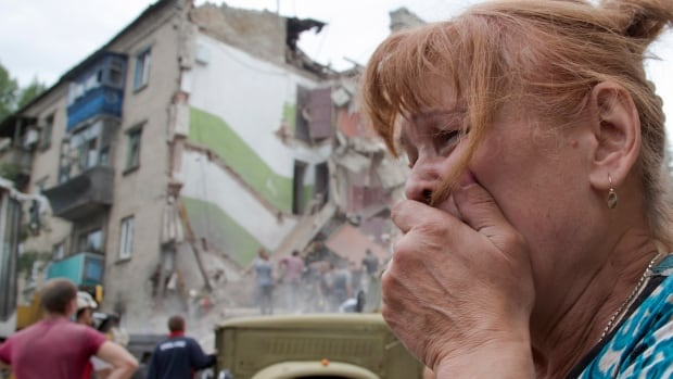 A woman cries near her collapsed apartment after an airstrike in Snizhne, 100 kilometres east from the city of Donetsk, eastern Ukraine on Tuesday.