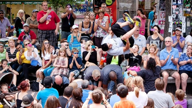 Crowds at Old Market Square catch the action at the Winnipeg Fringe Festival