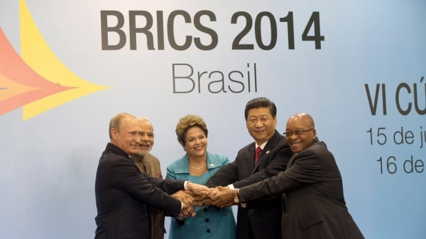 Leaders of the BRICS nations, from left, Russia's President Vladimir Putin, India's Prime Minister Narendra Modi, Brazil's President Dilma Rousseff, China's President Xi Jinping and South Africa's President Jacob Zuma, pose for a group photo during the BRICS summit in Fortaleza, Brazil on Tuesday.