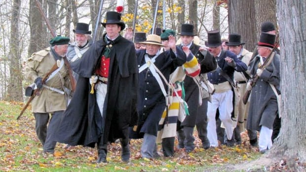 Bob Rennie leads a group of captured soldiers in a military reenactment. Rennie is portraying is great-great-great-great-grandfather Henry Bostwick, who arrested many of the 19 people tried in the Bloody Assize of Ancaster, some 200 years ago. Eight were hanged for high treason.