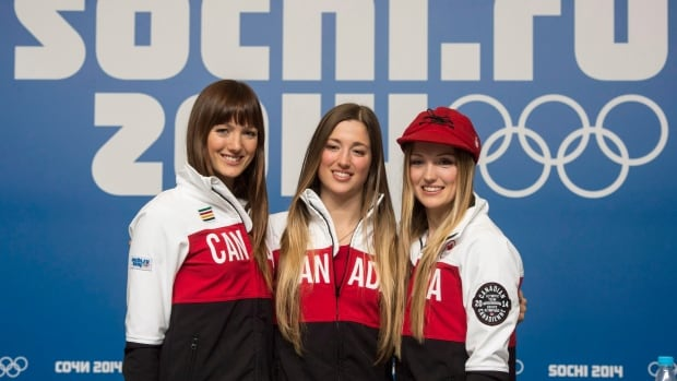 Women's moguls Olympic gold medalist Justine Dufour-Lapointe, right, is shown with sister and silver medalist Chloe, centre, and and sister Maxime at the Sochi Winter Olympics.
