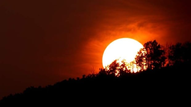 A resident of B.C.'s Peace River region resident submitted this picture of a smoky sunset. The Peace region is just one of many areas in Western and Northern Canada affected by wildfires and choked by their haze.
