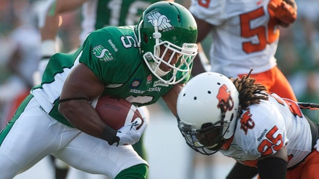 Running back Hugh Charles, left, had 86 yards on 13 carries in the Roughriders' 26-13 loss to B.C. last week. A Charles fumble led to the Lions' winning field goal and may have contributed to his release on Wednesday.