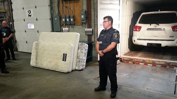 One of the cars retrieved from the RCMP's bust. Twenty-nine cars have so far been recovered, mostly from the Port of Montreal. The cars were stuffed in shipping containers padded with mattresses.