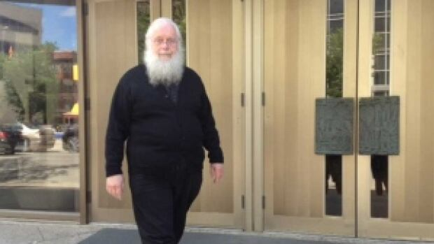 Seraphim Kenneth Storheim leaves the Winnipeg courthouse in June after his sentencing hearing. The former Orthodox priest convicted of sexually assaulting an altar boy will hear Thursday if he will be granted bail pending an appeal.