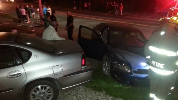 The driver lost control of his vehicle and crashed into a stop sign and a house before bouncing off a power pole and smashing into two parked cars.