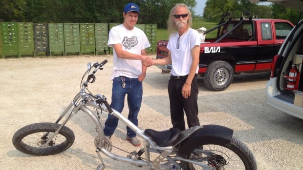 Steven Unruh, left, recovered Keith Dyck's custom bicycle on Thursday.