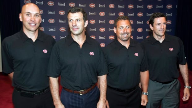 Patrice Brisebois, far right, is seen during a 2012 news conference with Montreal Canadiens general manager Marc Bergevin, second from left,  Sylvain Lefebvre, left, and Martin Lapointe, second from the right.