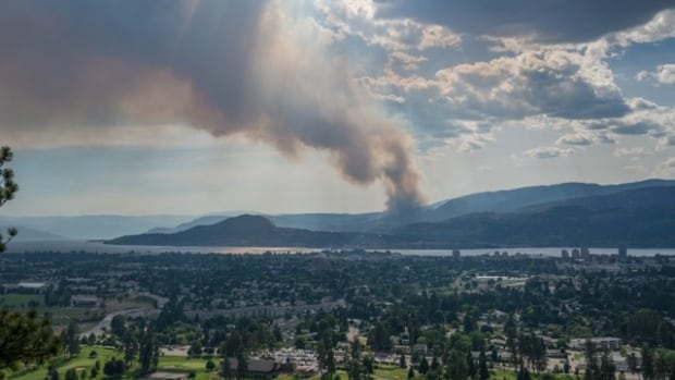 Smoke rises from the Smith Creek fire in West Kelowna