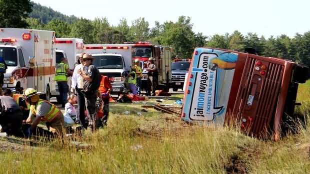 First responders treated injured passengers at the scene of a Quebec charter bus crash on Interstate 87 near North Hudson, N.Y., on Friday that killed a Quebec teenager. The surving passengers began returning to Quebec on Friday night.